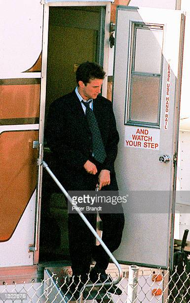 Actor Noah Wyle zips up his pants as he steps out of his trailer in March 2001 on the set of 'ER' in Los Angeles CA