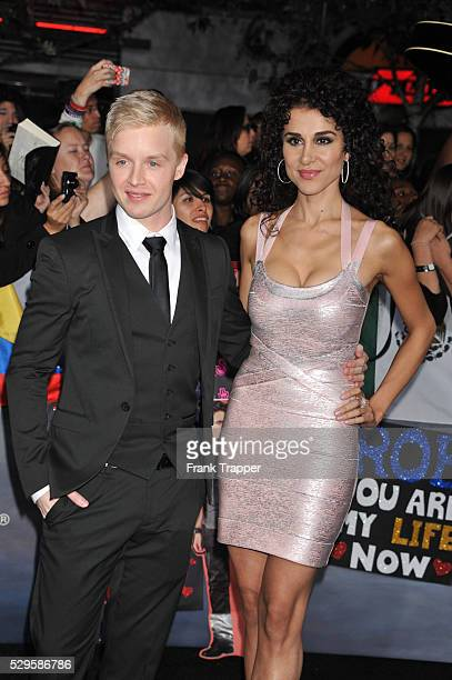 Actor Noel Fisher and guest arrive at the premiere of The Twilight Saga Breaking Dawn Part 2 held at the the Nokia Theater at LA Live
