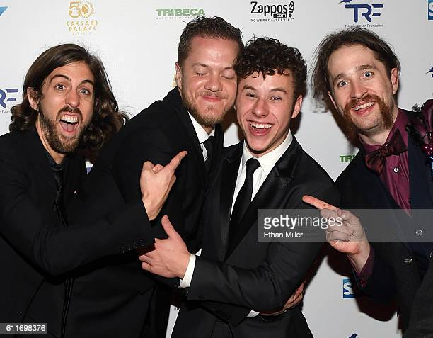 Actor Nolan Gould is photobombed by guitarist Wayne Sermon singer/drummer Dan Reynolds and drummer Daniel Platzman of Imagine Dragons as they attend...
