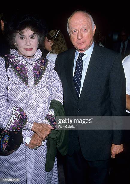 Actor Norman Lloyd and wife Peggy attend the Museum of Broadcasting Celebrate the 25th Anniversary of Los Angeles' KCET on July 26 1989 at the DGA...