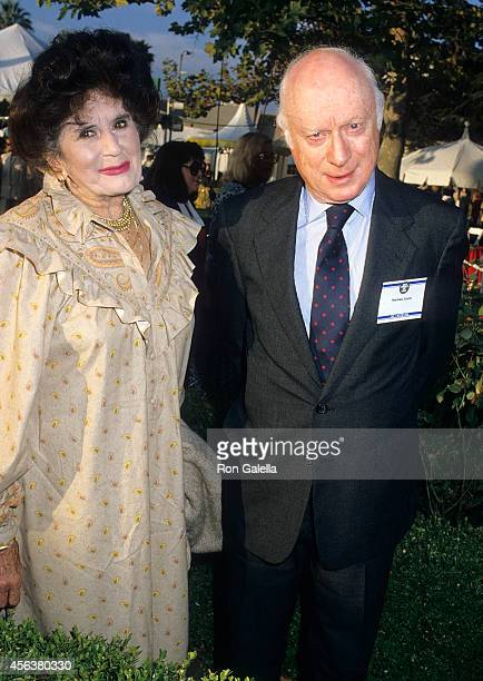 Actor Norman Lloyd and wife Peggy attend USA Today's Fifth Anniversary Celebration on September 10 1987 at Culver Studios in Culver City California