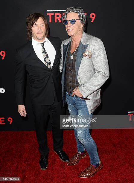 Actor Norman Reedus and actor Mickey Rourke attend the premiere of Open Road's 'Triple 9' at Regal Cinemas LA Live on February 16 2016 in Los Angeles...