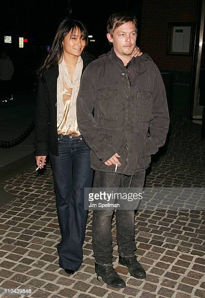Actor Norman Reedus and guest arrive at the screening of 'My Blueberry Nights' hosted by The Cinema Society and IWC at the Tribeca Grand Screening...