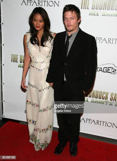 Actor Norman Reedus and model Jarah Mariano arrive for the Los Angeles premiere of 'The Boondock Saints II All Saints Day' at ArcLight Cinemas on...