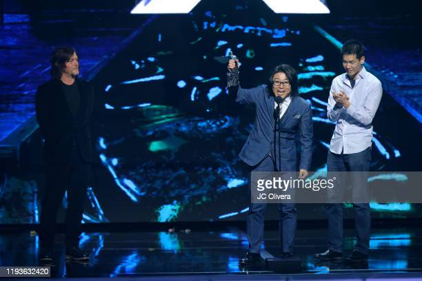 Actor Norman Reedus Hideaki Itsuno and guest seen onstage during The Game Awards 2019 at Microsoft Theater on December 12 2019 in Los Angeles...