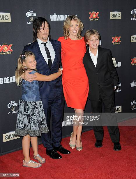 Actor Norman Reedus with Alyssa Nicotero and Deven Nicotero arrive for AMC Celebrates The Season 5 Premiere Of 'The Walking Dead' held at AMC...