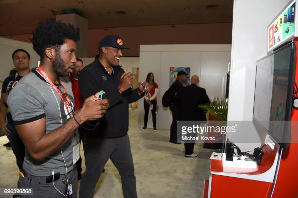 Actor Nyambi Nyambi and basketball player Rick Fox visit the Nintendo booth at the 2017 E3 Gaming Convention at Los Angeles Convention Center on June...