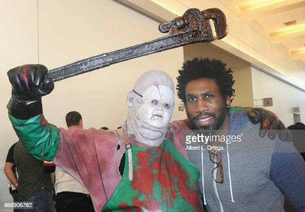 Actor Nyambi Nyambi and horror cosplayer Chris Hannan attend day 2 of the 2017 Monsterpalooza held at Pasadena Convention Center on April 9 2017 in...