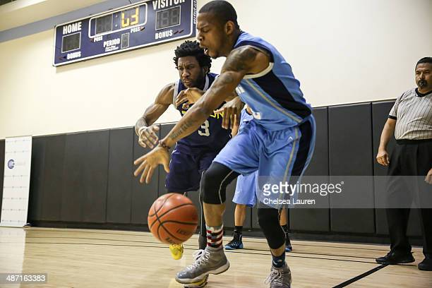 Actor Nyambi Nyambi and rapper Kosine play in the ELeague celebrity basketball playoffs at Equinox Sports Club West LA on April 27 2014 in Los...