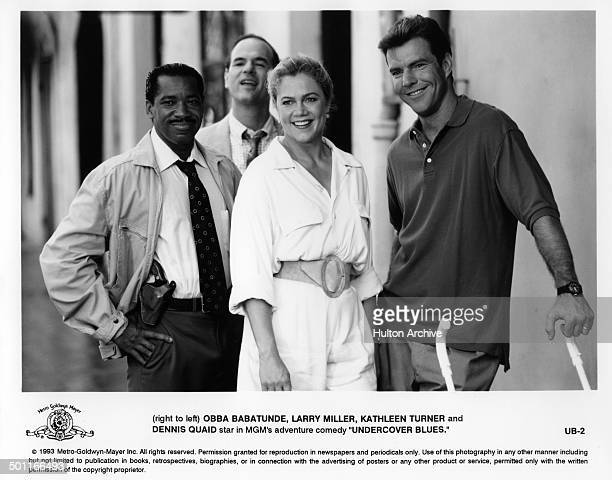 """Actor Obba Babatundé, Larry Miller, Kathleen Turner and Dennis Quaid in a scene for the MGM movie """"Undercover Blues"""" circa 1993."""