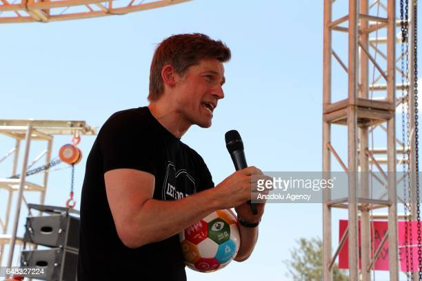 Actor of Game of Thrones Nikolaj CosterWaldau delivers a speech as he referees during Global Goals World Cup women's soccer tournament as the newest...