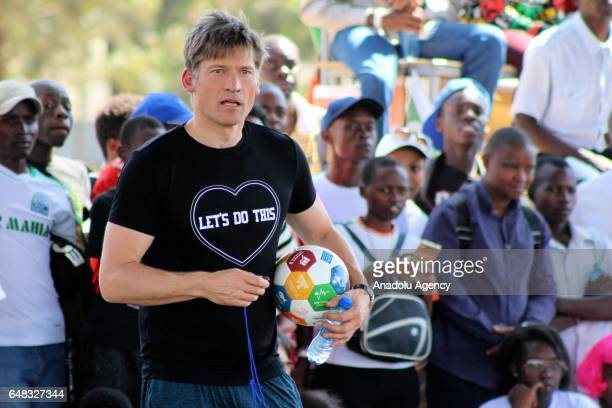 Actor of Game of Thrones Nikolaj CosterWaldau is seen with a ball as he referees during Global Goals World Cup women's soccer tournament as the...