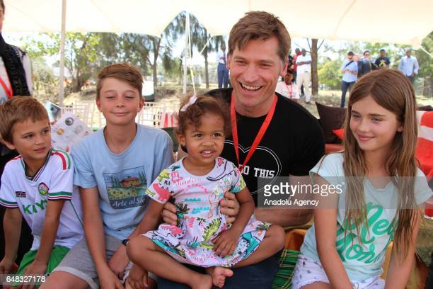 Actor of Game of Thrones Nikolaj CosterWaldau is seen with children as he referees during Global Goals World Cup women's soccer tournament as the...