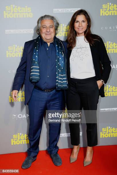 Actor of the movie Christian Clavier and his companion Isabelle De Araujo attend the 'Si j'etais un Homme' Paris Premiere at Cinema Gaumont Opera on...