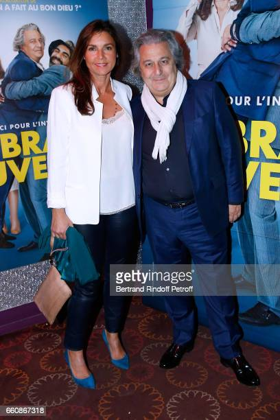 Actor of the movie Christian Clavier and his wife Isabelle de Ajauros attend the 'A bras ouverts' Paris Premiere at Cinema Gaumont Opera on March 30...
