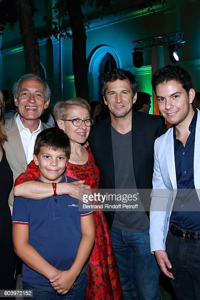 Actor of the movie Guillaume Cannet poses with Grand sons of Emile Zola in which he plays the role Martine Le BlondZola her brother Bernard Le...