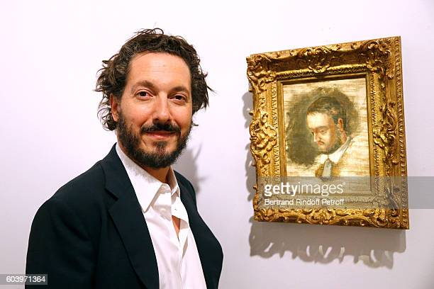 Actor of the movie Guillaume Gallienne poses in front of a portrait of Emile Zola in which he plays the role during the 'Cezanne et Moi' Premiere...