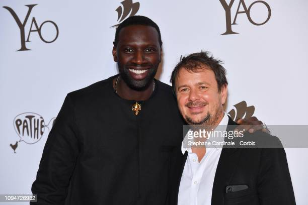 Actor of the movie Omar Sy and director of the movie Philippe Godeau attend 'Yao' Paris Premiere at Le Grand Rex on January 15 2019 in Paris France