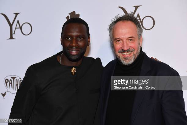 Actor of the movie Omar Sy and lawyer Cristian Balsamidis attends 'Yao' Paris Premiere at Le Grand Rex on January 15 2019 in Paris France