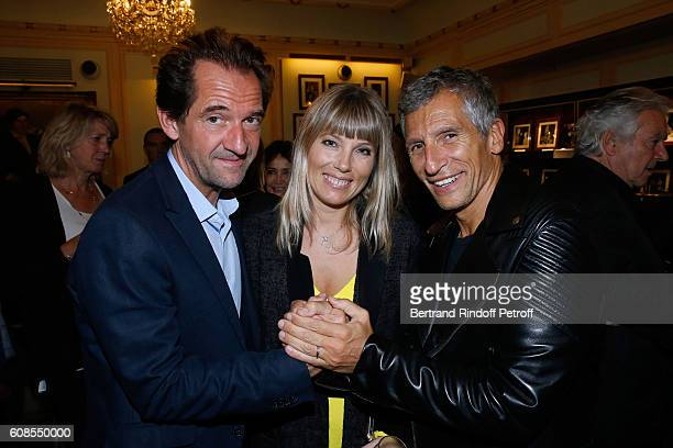 Actor of the play Stephane De Groodt TV Presenter Nagui with his wife actress Melanie Page attend the 'Tout ce que vous voulez' Theater Play at...