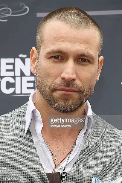 Actor of the Telemundo telenovela 'Senor de los dos Cielos' Rafael Amaya receives an award by New York City Council member Ydanis Rodriguez and New...