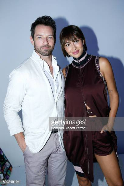 Actor of TV Series 'Teen Wolf' Ian Bohen and Actress of Netflix TV Series 'Orange Is the New Black' Jackie Cruz attend the Jean Paul Gaultier Haute...