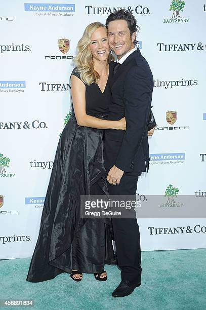 Actor Oliver Hudson and Erinn Bartlett arrive at the 2014 Baby2Baby Gala presented by Tiffany Co honoring Kate Hudson at The Book Bindery on November...