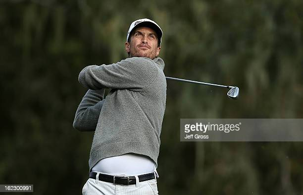 Actor Oliver Hudson hits a shot during the first round of the ATT Pebble Beach National ProAm at the Monterey Peninsula Country Club on February 7...