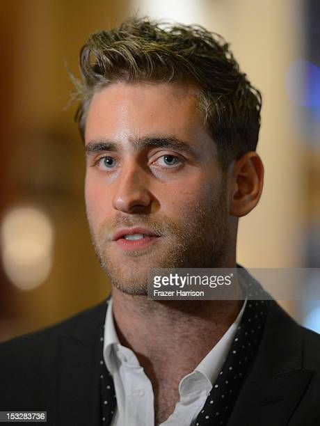 Actor Oliver JacksonCohen attends the screening of 'World Without End' presented by ReelzChannel at The Grove on October 2 2012 in Los Angeles...