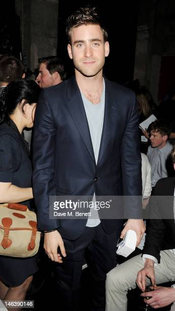 Actor Oliver JacksonCohen attends the Spencer Hart Spring/Summer 2013 catwalk show during London Collections Men at the Old Selfridges Hotel on June...