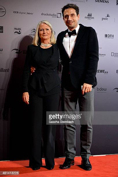 Actor Oliver Mommsen and his mother Claudia pose prior to the German Sustainability Award 2013 at Maritim Hotel on November 22, 2013 in Duesseldorf,...