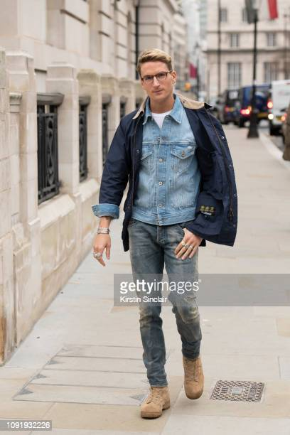 Actor Oliver Proudlock wears a Diesel denim jacket and jeans during London Fashion Week Men's January 2019 on January 07 2019 in London England