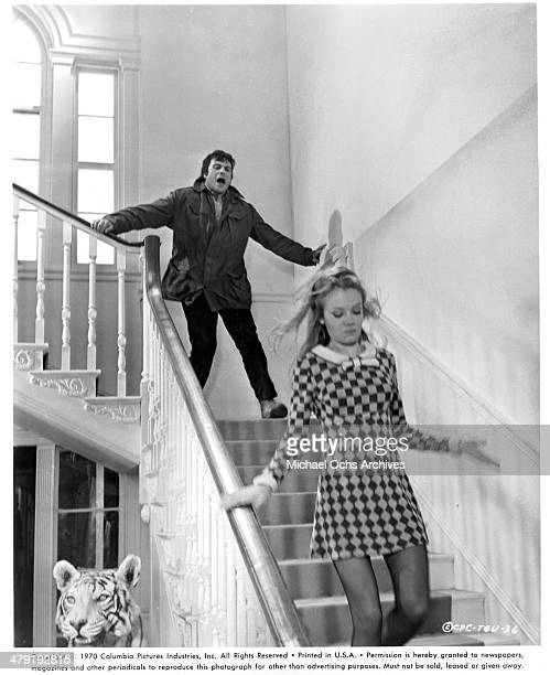 "Actor Oliver Reed and actress Hayley Mills run in a scene from the Columbia Picture movie ""Take a Girl Like You"" circa 1970."