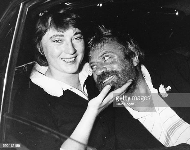 Actor Oliver Reed and his young wife Josephine smiling in the back of a car as they leave an event at the National Film Theatre London November 13th...