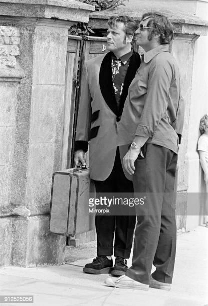 Actor Oliver Reed dressed in Teddy Boy clothing during a break in filming of the pop opera 'Tommy' by director Ken Russell 13th June 1974