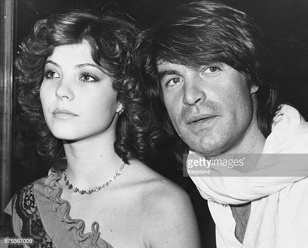 Actor Oliver Tobias and model Sasky arriving at the premiere of the film 'The Stud' London April 12th 1978