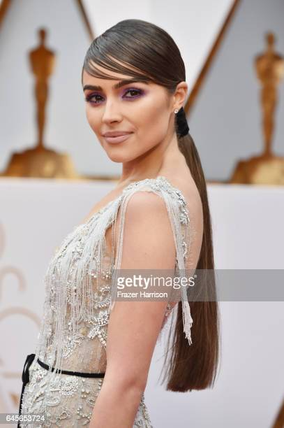 Actor Olivia Culpo unveils a oneofakind Marchesa for Stella Artois gown featuring beads made from the Stella Artois LimitedEdition Chalices that...