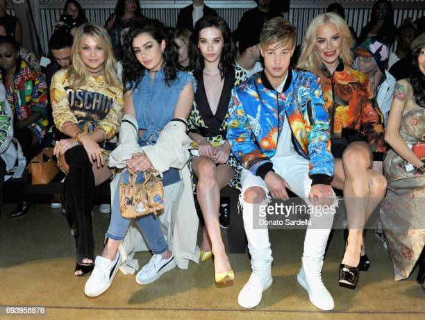 Actor Olivia Holt singer Charli XCX influencers Amanda Steele Cameron Dallas and Gigi Gorgeous attend Moschino Spring/Summer 18 Menswear and Women's...