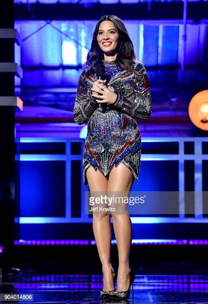 Actor Olivia Munn speaks on stage at The 23rd Annual Critics' Choice Awards at Barker Hangar on January 11 2018 in Santa Monica California