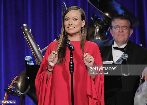 Actor Olivia Wilde speaks onstage at the Friars Club Honoring Martin Scorsese With the Entertainment Icon Award at Cipriani Wall Street on September...