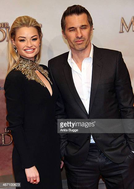 Actor Olivier Martinez and actress Emma Rigby attend the The Physician German premiere at Zoo Palast on December 16 2013 in Berlin Germany