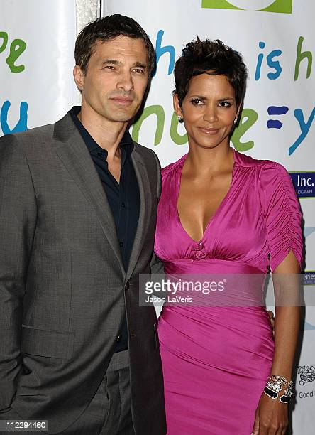 Actor Olivier Martinez and actress Halle Berry attend the 2011 Silver Rose gala & auction at Beverly Hills Hotel on April 17, 2011 in Beverly Hills,...