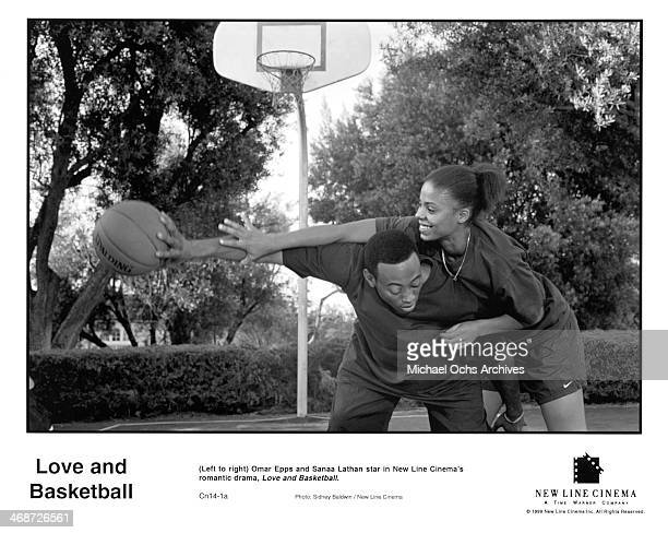 Actor Omar Epps and actress Sanaa Lathan on set of the New Line Cinema movie Love Basketball circa 2000