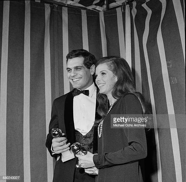 Actor Omar Sharif and Samantha Eggar pose with their Golden Globe Awards in Los AngelesCA