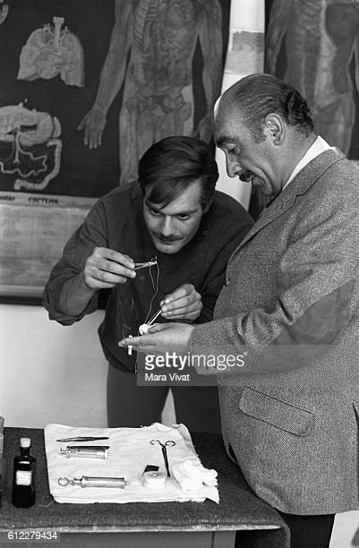 Actor Omar Sharif practices stitching in preparation for his role as the title character in Doctor Zhivago released in 1965