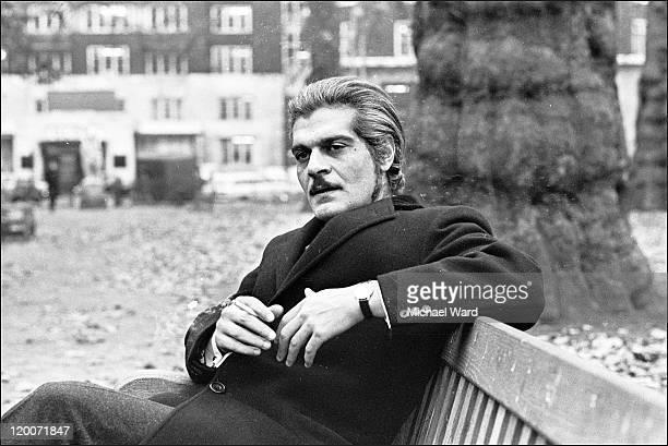 Actor Omar Sharif sitting on a park bench 1969