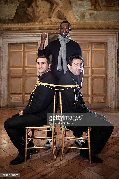 Actor Omar Sy and directors Eric Toledano and Olivier Nakache are photographed for Self Assignment on February 20 2015 in Paris France