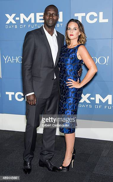 """Actor Omar Sy and Helene Sy attend the """"X-Men: Days Of Future Past"""" world premiere at Jacob Javits Center on May 10, 2014 in New York City."""