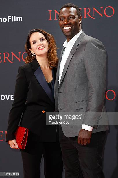 Actor Omar Sy and his wife Helene Sy attend the German premiere of the film 'INFERNO' at Sony Centre on October 10, 2016 in Berlin, Germany.
