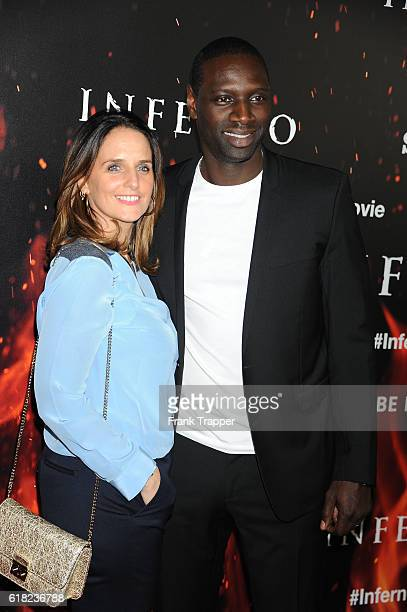 """Actor Omar Sy and wife Helene attend the screening of Sony Pictures Releasing's """"Inferno"""" held at the DGA Theater on October 25, 2016 in Los Angeles,..."""